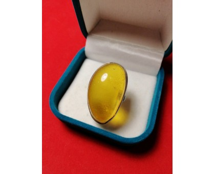 Silver ring inset amber